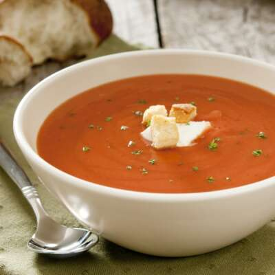White bowl with cream of tomato soup