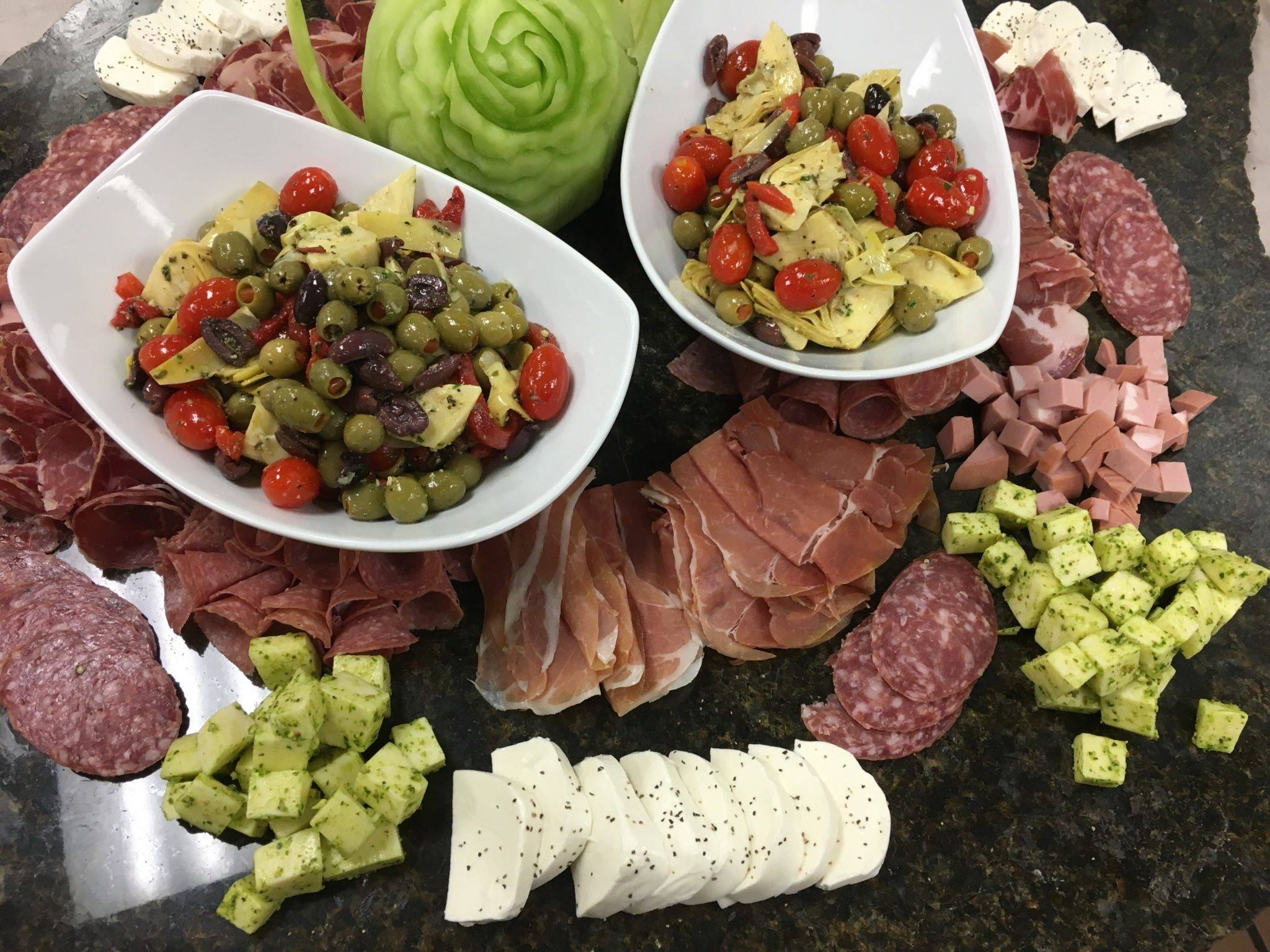 Antipasto tray with variety of meats and cheeses