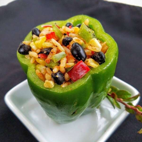 Bell pepper stuffed with rice, veggies, and black beans