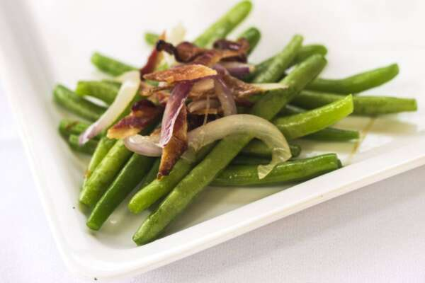 Green beans topped with onions and bacon