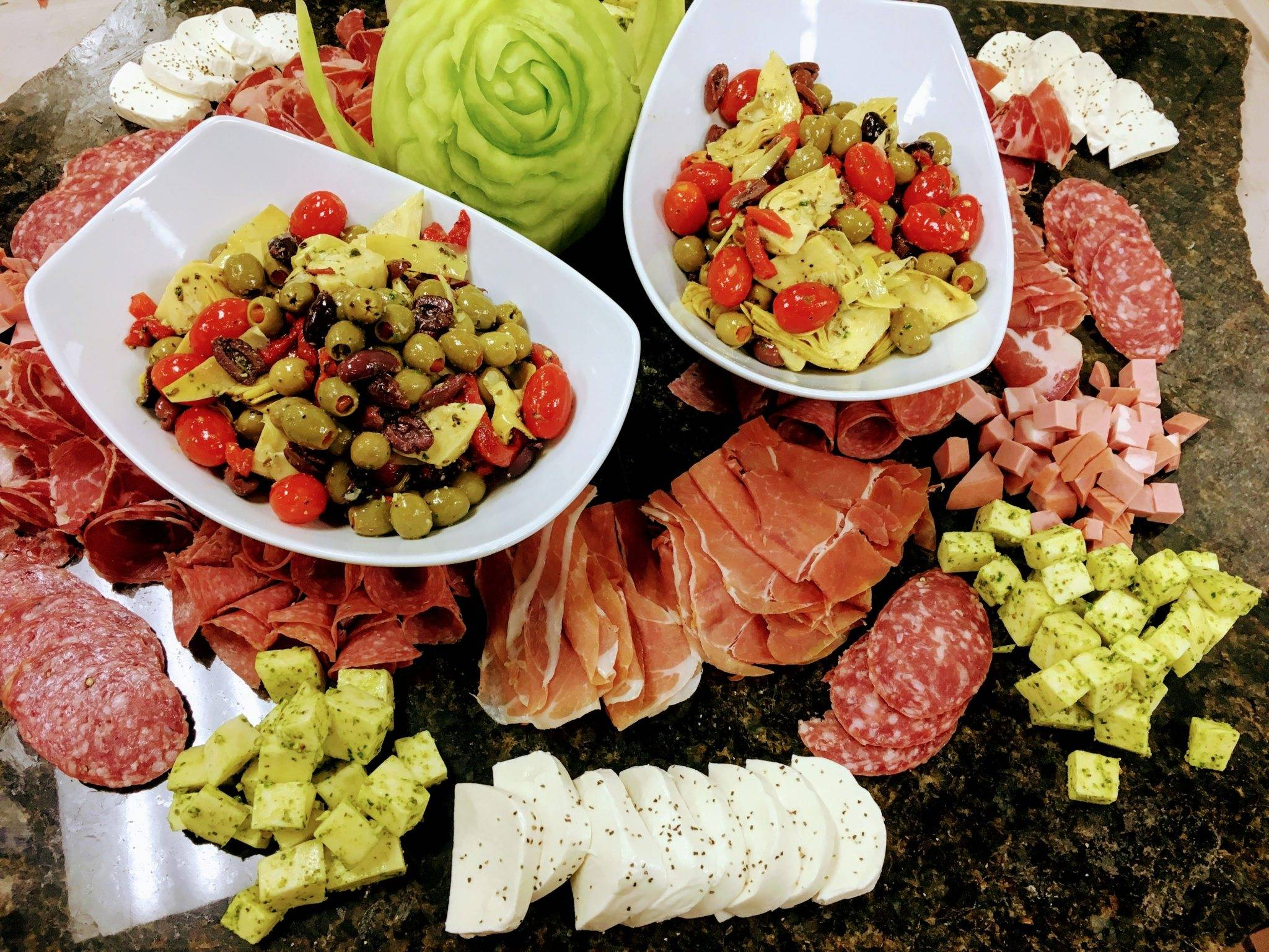 Cheese, Aged Sliced Italian Meats, artichokes, olives, peppers, on marble slab display
