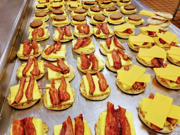 English muffin sandwich with bacon or sausage and cheddar cheese