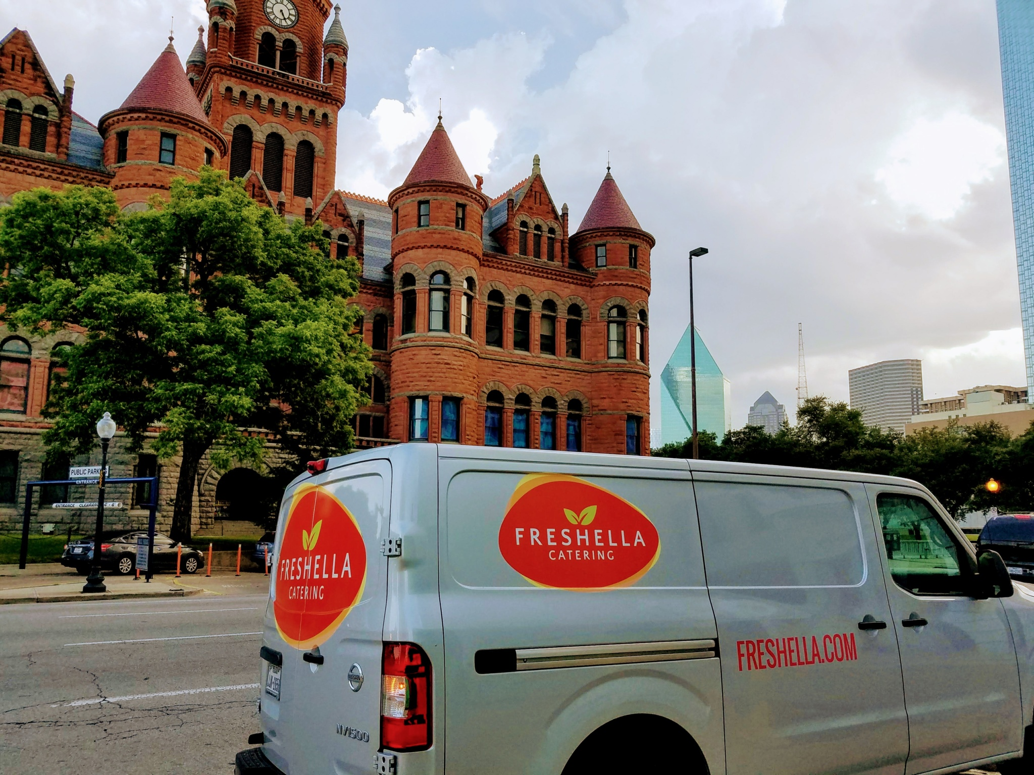 Silver Freshella Catering Van with the Old Red Museum in Dallas on the background