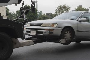 tow truck delivers damaged vehicle