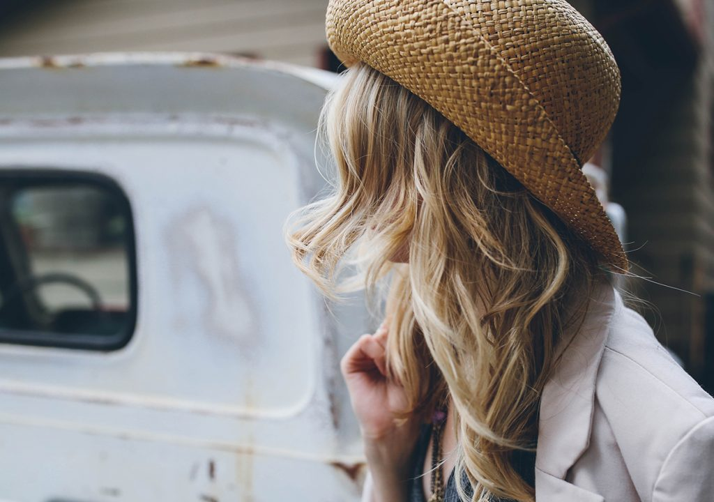 woman looking at an old car
