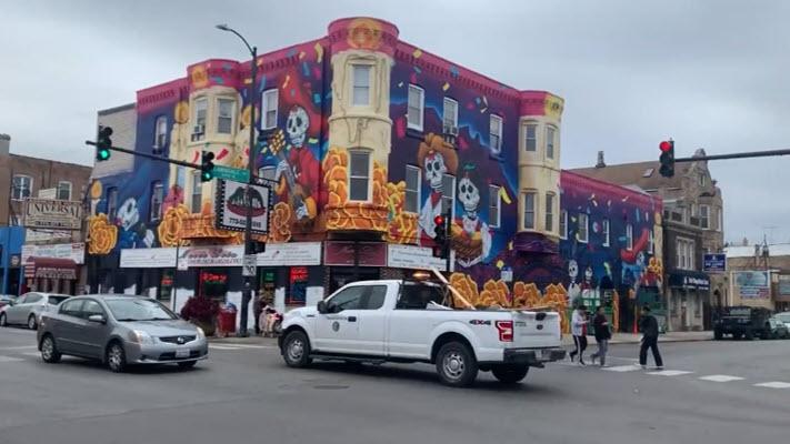 Huge Day of the Dead mural wraps around Little Village restaurant
