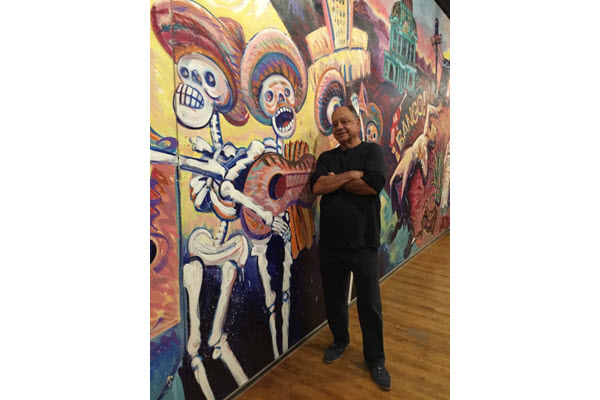 Actor Cheech Marin displaying private art collection 'Papel Chicano Dos' at the Loveland Museum
