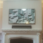 image of fireplace mantle with an painting