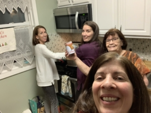 Picture of my sisters and I cooking at my Mom's!