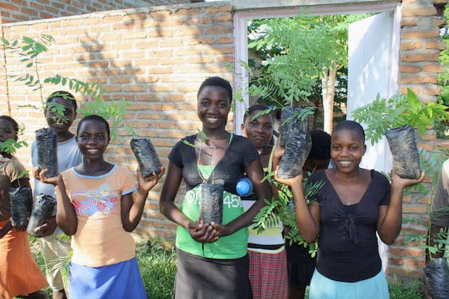 Determined to Develop School Children Assist with Reforestation Project 1