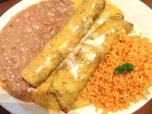 Sunset Beef Enchiladas. Two to an order served with Rice and Beans.