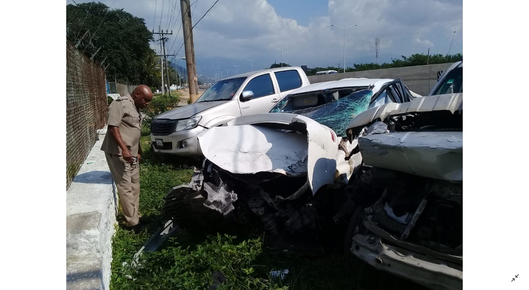 police officer examing a vechile following a crash