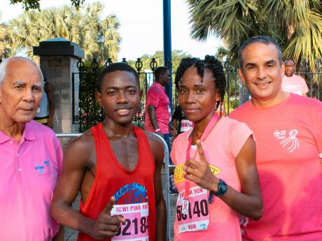 ICWI Pink Run winners from left to right (in the middle) Henry Thomas and Arieta Martin and from left, the Chairman of ICWI Dennis  Lalor and Paul Lalor the president of ICWI