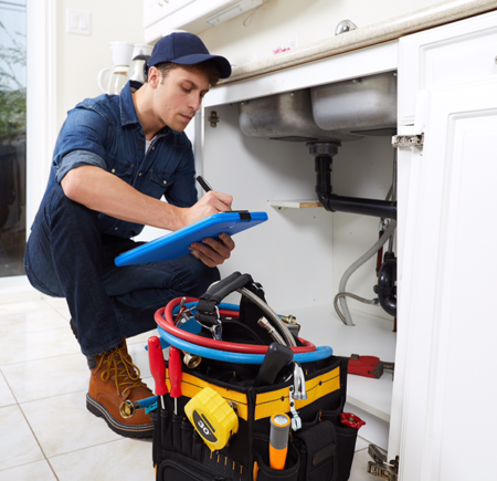Plumber fixing kitchen leaks in Delray Beach, Florida