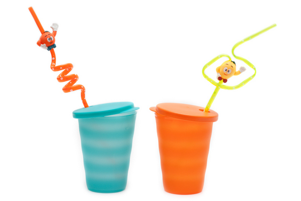 Plastic orange and blue glasses pipe for cocktail on white background
