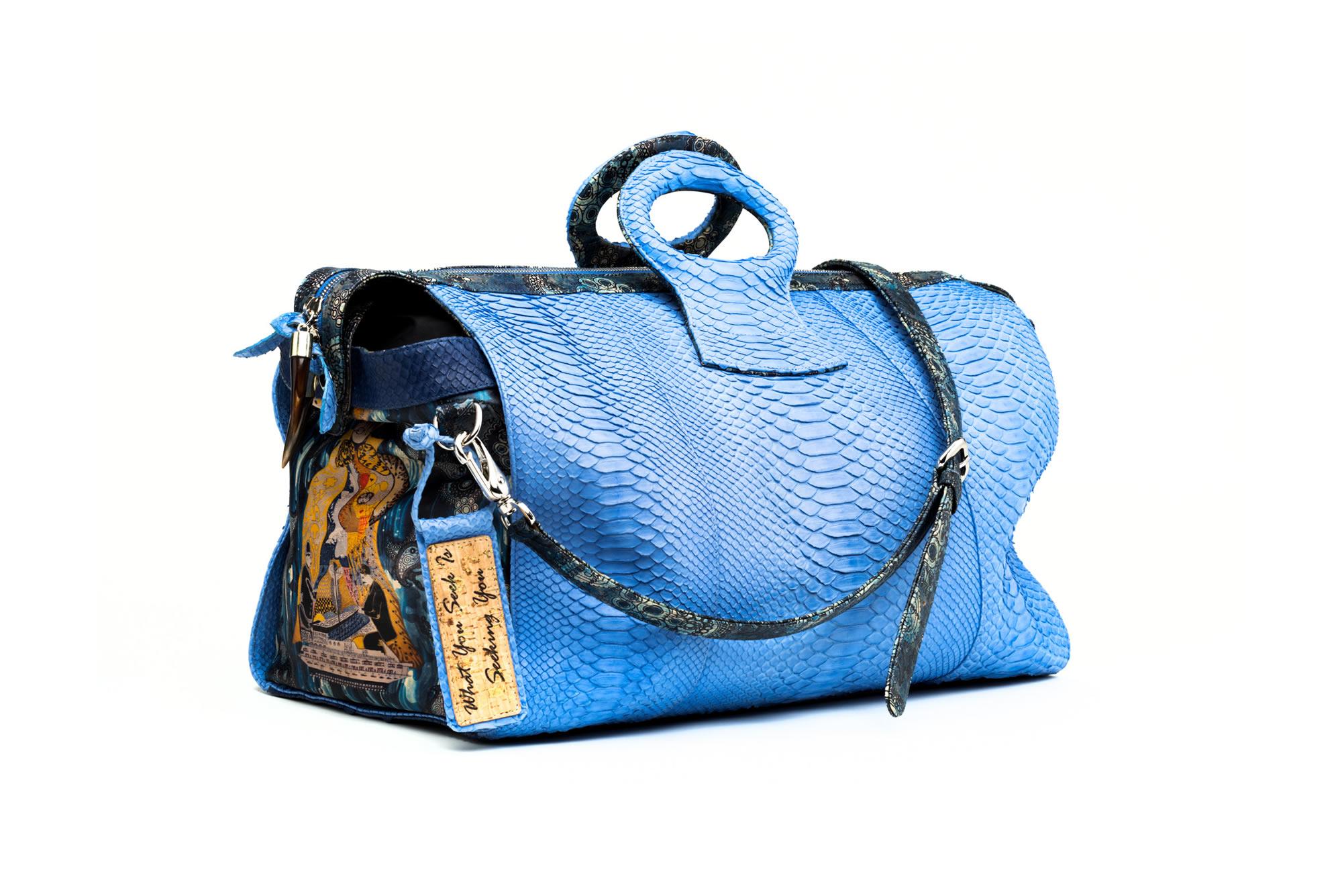 DUFFEL BLUE PYTHON LADY CHARITY