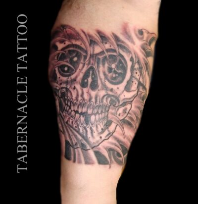 Black and grey skull tattoos