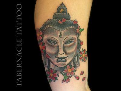 Buddha tattoo with cherry blossoms