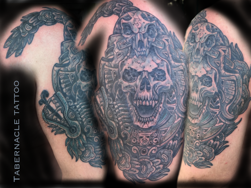 Black and Gray Aztec half-sleeve tattoo