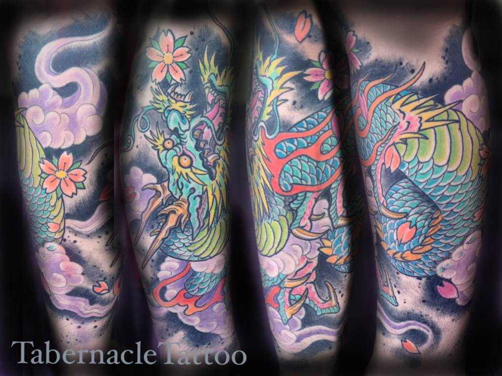 Dragon half sleeve tattoo