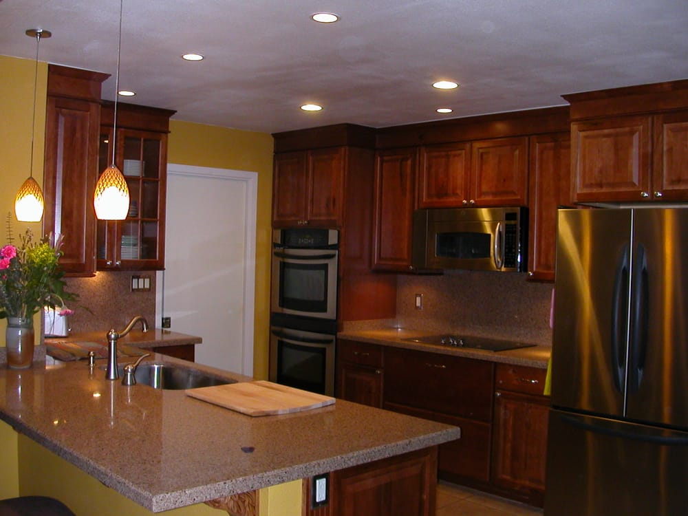 Kitchen remodel with recessed lighting, under cabinet lighting and hanging pendant lights