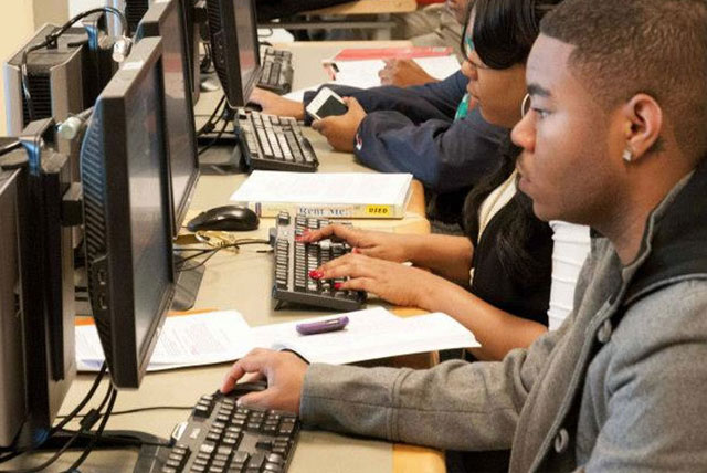 Online Identity: HBCU students using computers in the library.