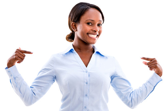 Successful young African American female pointing at herselfsmil