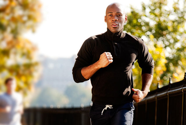A black male HBCU student running on campus following healthy living tips.
