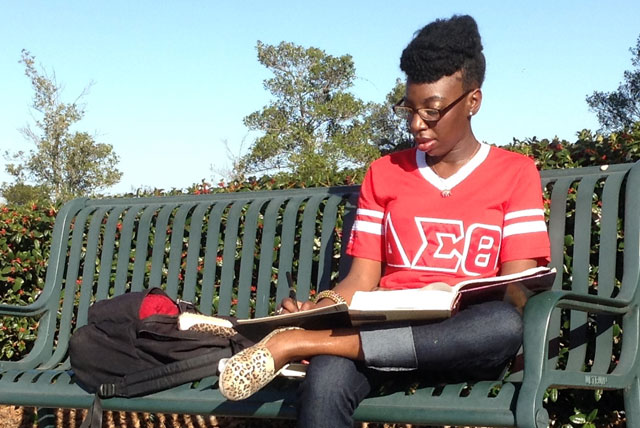 Delta Sigma Theta member T'Edra Jackson studies outside on the campus of Paul Quinn College.