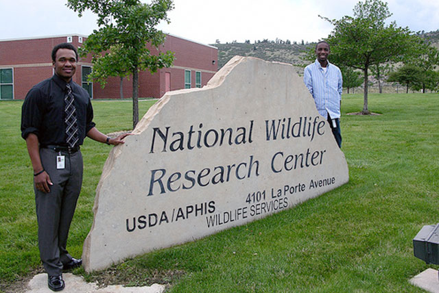 Thurgood Marshall College Fund interns Joseph Williams (left) and Aaron Thomas stand in front of the National Wildlife Research Center Sign during their Government Internships during the summer of 2012.
