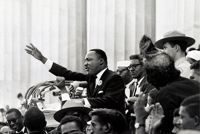 "Martin Luther King Jr delivers the ""I have a dream"" speech from the podium August 28, 1963. This became the most famous of the Martin Luther King Jr Quotes."