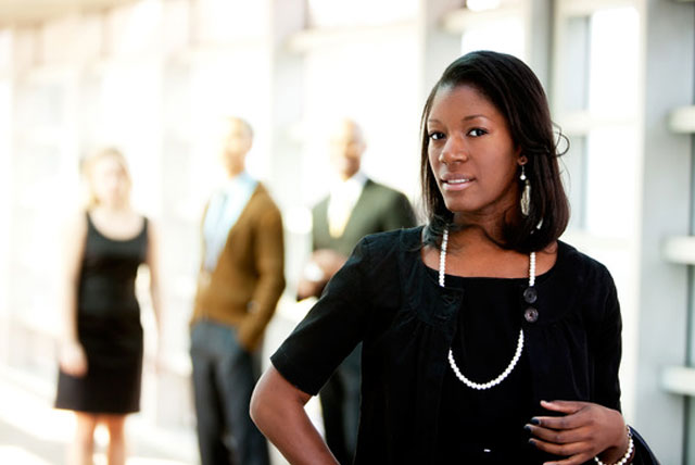 A female Student Government Association president stands out in front of fellow SGA members.