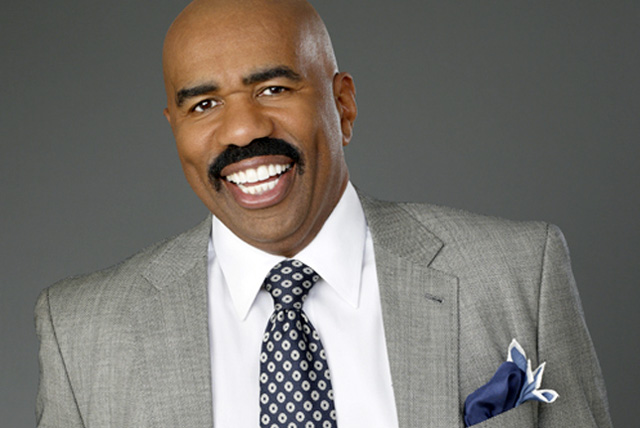 American actor, comedian, entertainer, television/radio personality and author Steve Harvey smiles for photo shoot.