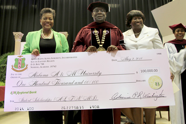 Alabama A&M University President Andrew and First Lady Abbiegail Hugine accept $100,000 check for scholarships from Adrienne P-K Washington, South Eastern Regional Director of Alpha Kappa Alpha Sorority, Inc.