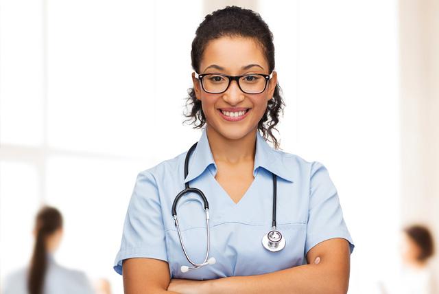 Tylenol Scholarship: Smiling female african American doctor or nurse in eyeglasses with stethoscope.