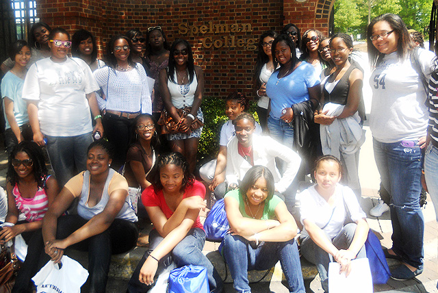 HBCU College Tours: A group of female high schools students pose in front of Spelman College.