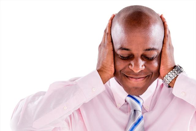 Black Greeks fraternity member covering his ears.