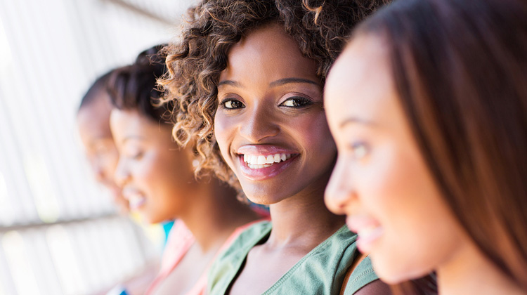 Group of happy African American students on a HBCU campus tour close-up.