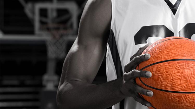 African American Basketball player with basketball