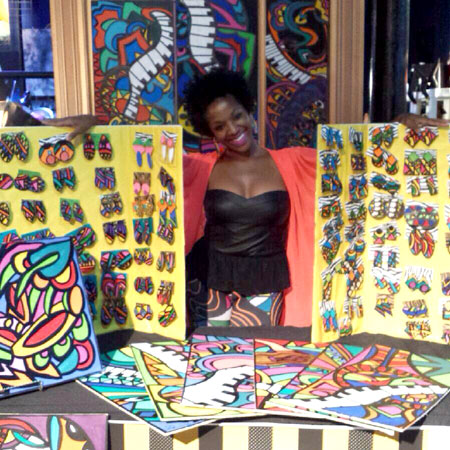Melissa Mitchell, owner of Abeille Creations, a custom art company specializing in custom art and hand painted jewelry.
