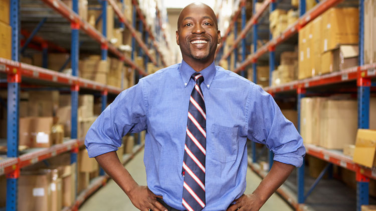 Portrait of a African American businessman in logistics warehouse