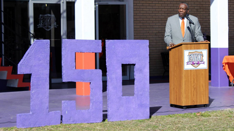 President Nathaniel Glover addresses Edward Waters College faculty, staff, students the university's 150th anniversary kick-off event.