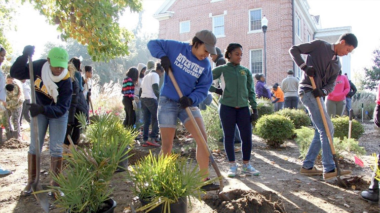 2016 Retool Your School: Students on the campus of Florida A&M University work to improve the grounds by planting shrubs and trees.