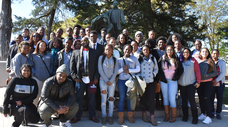 HBCU College Tours: Students on the 2015 Educational Student Tours pose in front of famous Booker T. Washington's Lifting the Veil of Ignorance monument on the campus of Tuskegee University.