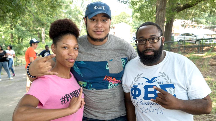 Black Greeks from Phi Beta Sigma and Alpha Kappa Alpha pose on the campus of North Carolina Central University.