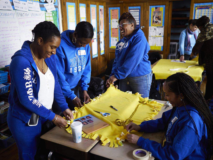 Members of Zeta Phi Beta Sorority put in Community service time at a Harlem school on MLK Day