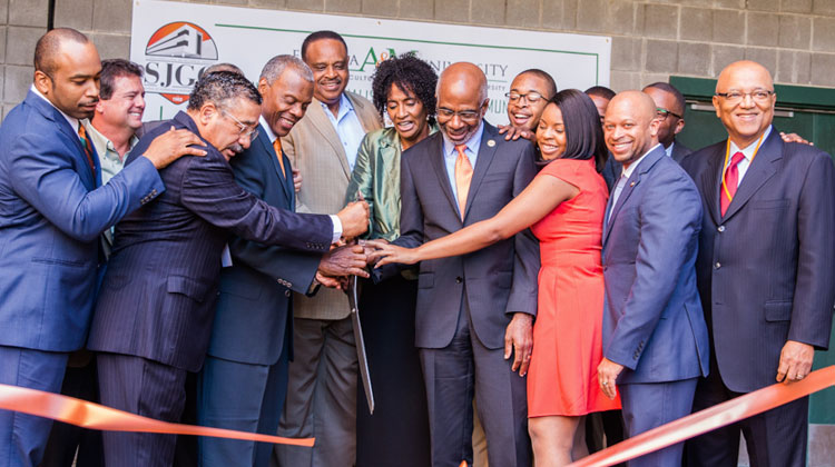 Owners of the Black Television News Channel and Florida Agricultural and Mechanical University administrators participate in a ribbon-cutting from the headquarters of the future channel.