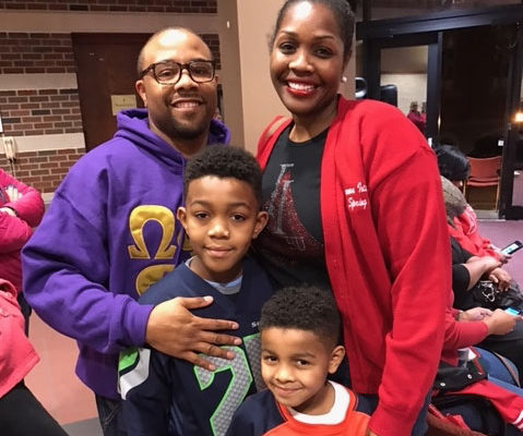 Black Greeks Roland and Bethany Criswell with their two boys.