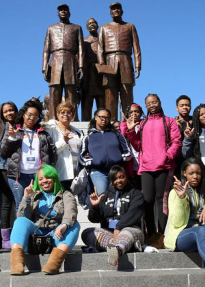 Students sit on the steps of Lincoln University Buffalo Soldier Memorial Plaza.