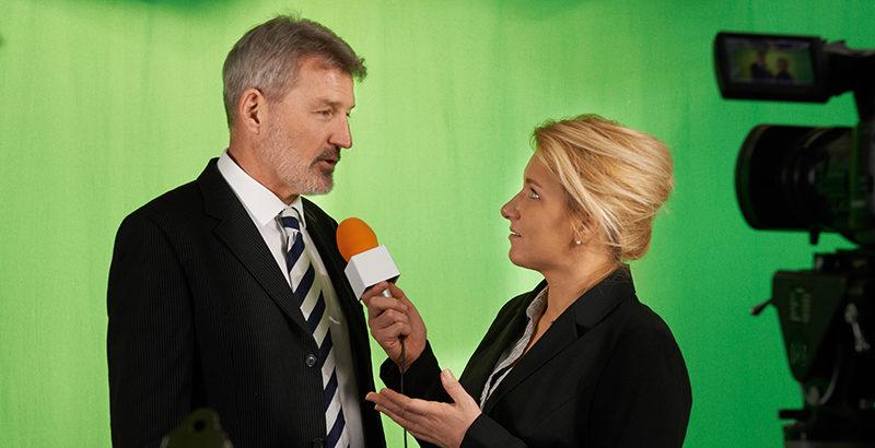 Interviewer and businessman on green screen